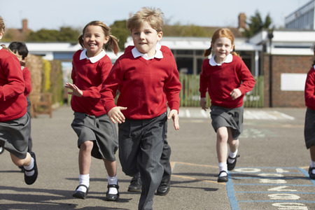 school playground: Elementary School Pupils Running In Playground