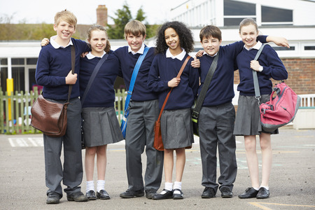 school uniforms: Portrait Of Elementary School Pupils In Playground