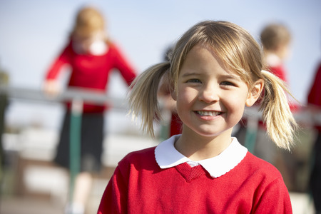 uniform student: Portrait Of Female Elementary School Pupil In Playground