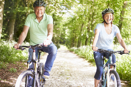 cycle ride: Senior Couple On Cycle Ride In Countryside