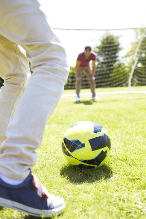 11 year old: Father And Son Playing Football Together Stock Photo