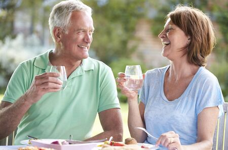 beautiful middle aged woman: Senior Couple Enjoying Outdoor Meal Together