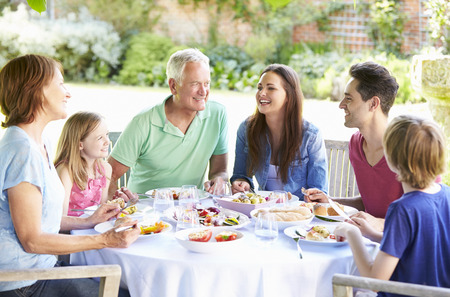 9 year old: Multi Generation Family Enjoying Outdoor Meal Together Stock Photo