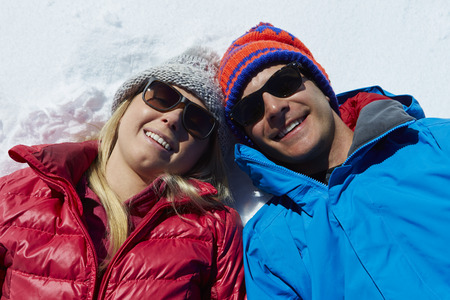 Overhead Shot Of Couple Having Fun On Winter Holiday