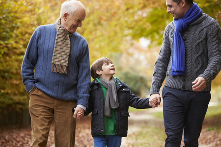grandfather and grandson: Male Multl Generation Family Walking Along Autumn Path