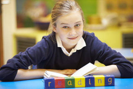 11 year old girl: Word Learning Spelt In Wooden Blocks With Pupil Behind