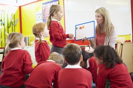 pupils: Teacher Teaching Spelling To Elementary School Pupils