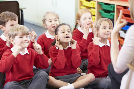 touching toes: Pupils Copying Teachers Actions Whilst Singing Song