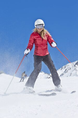 one woman: Woman On Ski Holiday In Mountains