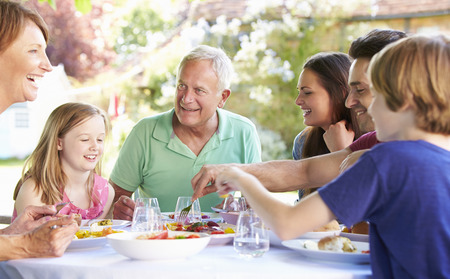 11 year old girl: Multi Generation Family Enjoying Outdoor Meal Together Stock Photo