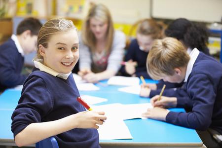 先生と教室で生徒の肖像画 写真素材