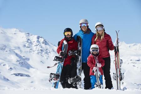 snowboard: Family On Ski Holiday In Mountains