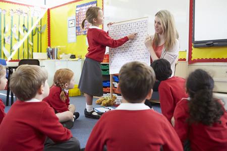 pupils: Teacher Teaching Maths To Elementary School Pupils