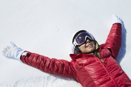 ski: Overhead Shot Of Girl Having Fun On Winter Holiday