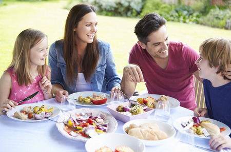 11 year old girl: Family Enjoying Outdoor Meal Together