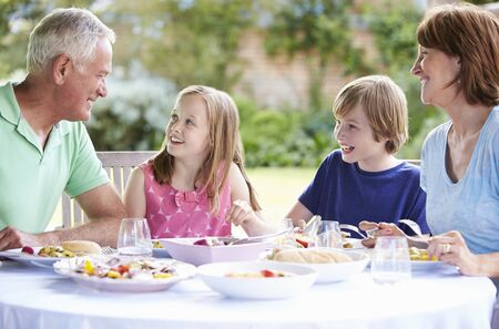 old girl: Grandparents With Grandchildren Enjoying Outdoor Meal
