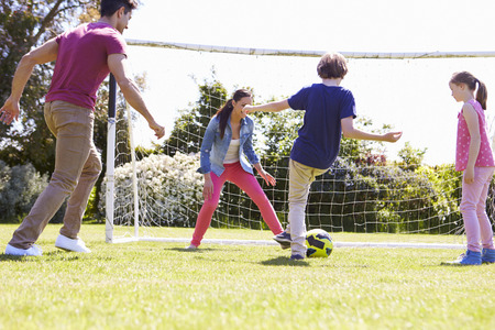 mummy: Family Playing Football Together