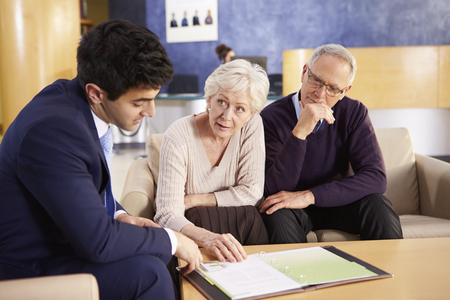 consultants: Senior Couple Meeting With Consultant In Hospital