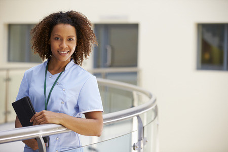 Portrait Of Female Nurse With Digital Tablet In Hospital Standard-Bild