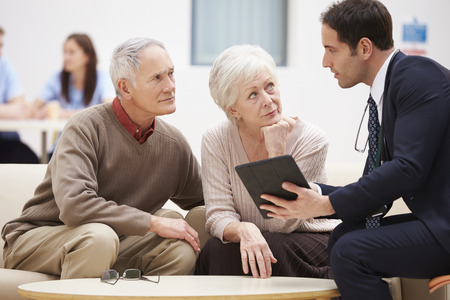 consoling: Senior Couple Discussing Test Results With Doctor