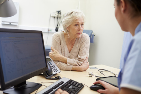 Senior Female Patient Has Appointment With Nurse