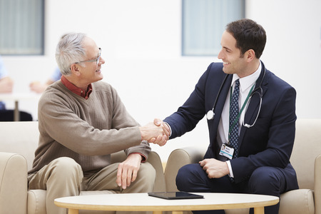 shaking: Senior Man Shaking Hands With Doctor