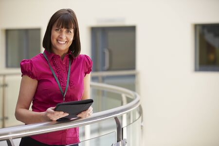 consultants: Female Consultant Using Digital Tablet In Hospital Stock Photo