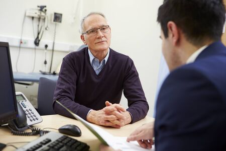 practioner: Consultant Discussing Test Results With Patient