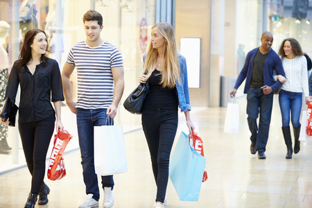 malls: Group Of Friends Shopping In Mall Together