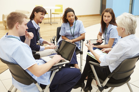 Members Of Medical Staff In Meeting Together Stock Photo