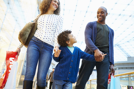 Child On Trip To Shopping Mall With Parents Stock Photo - 42307260