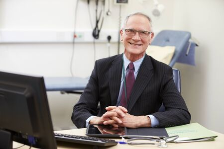 consultants: Portrait Of Male Consultant Working At Desk