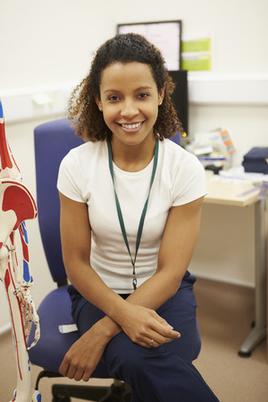 physical: Portrait Of Female Physiotherapist In Hospital
