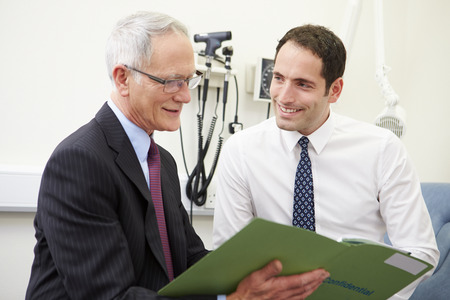 doctor appointment: Consultant Discussing Test Results With Patient