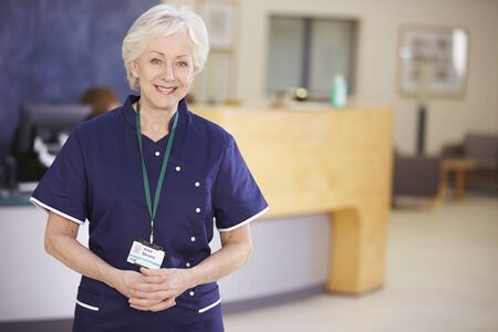 senior female: Portrait Of Female Nurse In Hospital Reception Stock Photo