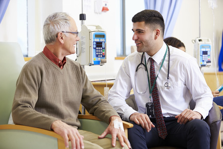Senior Man Undergoing Chemotherapy With Doctor Stock Photo