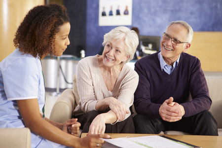 admission: Senior Couple Meeting With Nurse In Hospital Stock Photo