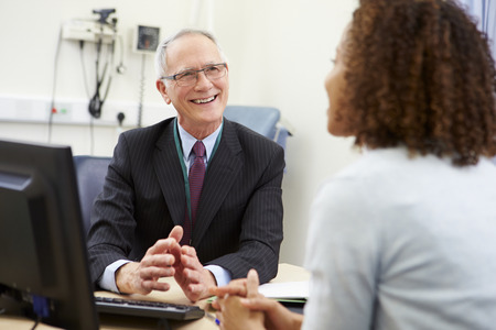 consultants: Consultant Meeting With Patient In Office Stock Photo