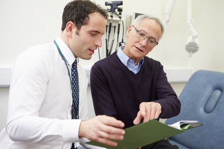 Consultant Discussing Test Results With Patient