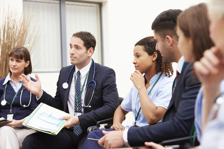 meeting together: Members Of Medical Staff In Meeting Together Stock Photo
