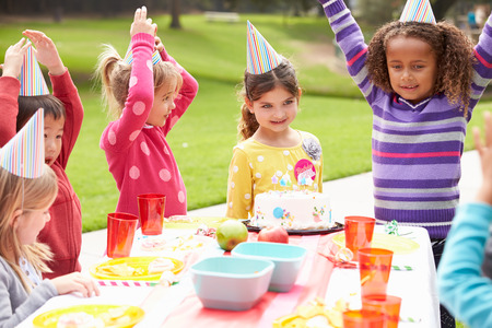 child birthday: Group Of Children Having Outdoor Birthday Party