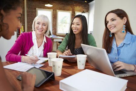 Group Of Businesswomen Meeting To Discuss Ideas Stock Photo