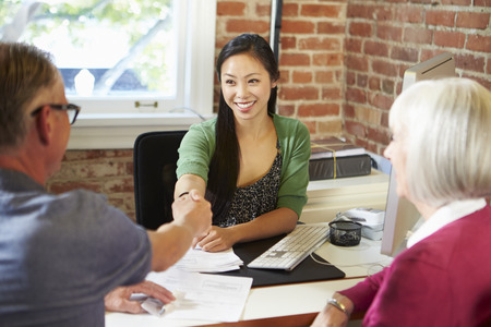 asian lady: Senior Couple Meeting With Financial Advisor In Office