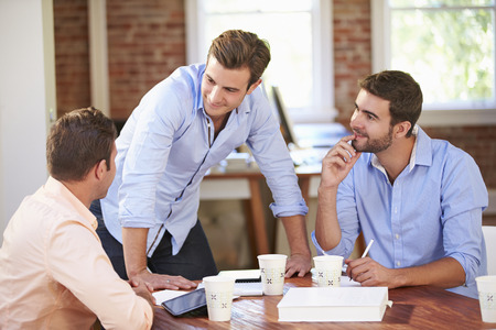 workers group: Group Of Businessmen Meeting To Discuss Ideas Stock Photo
