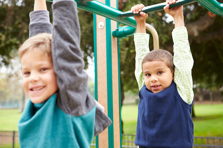 climbing frame: Two Young Boys On Climbing Frame In Playground
