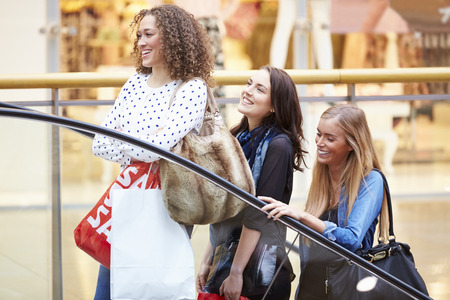 friends shopping: Three Female Friends Shopping In Mall Together