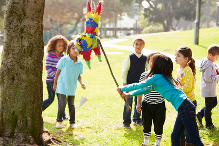 hitting: Children Hitting Pinata At Birthday Party