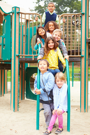 climbing frame: Young Children Sitting On Climbing Frame In Playground