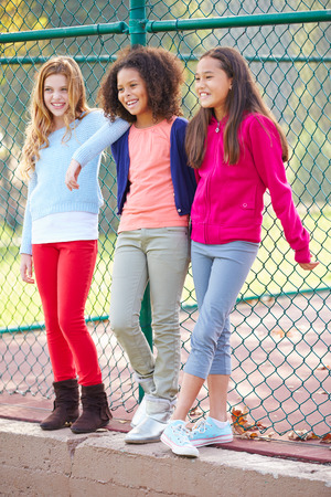 10 11 years: Three Young Girls Hanging Out Together In Park Stock Photo