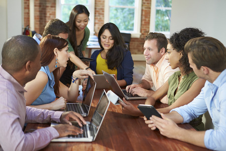 collaborating: Businessmen And Businesswomen Meeting To Discuss Ideas
